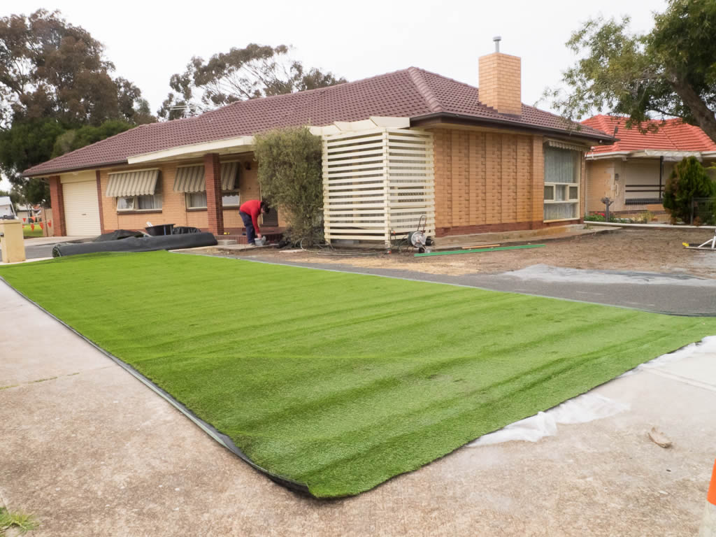 Align pieces of artificial lawn with each other