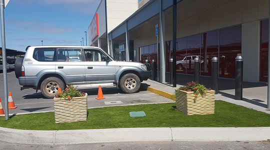 Artificial grass for commercial applications